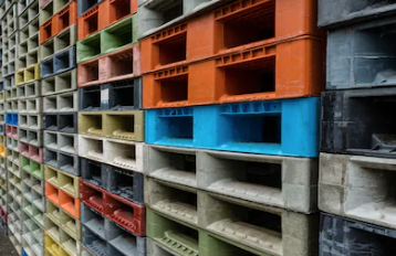 Recycled Plastic Pallets - Multi Colored Stacked Pallets